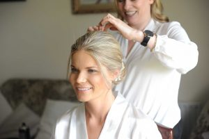 Bridal Upstyle with height and loose pieces around the face
