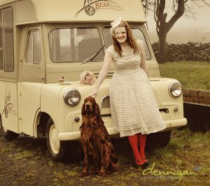 vintage wedding hair style girl with redsetter in front of a vintage van