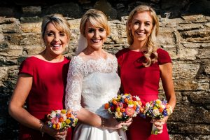 Bride and Bridesmaids photographed with rich coloured bouquets