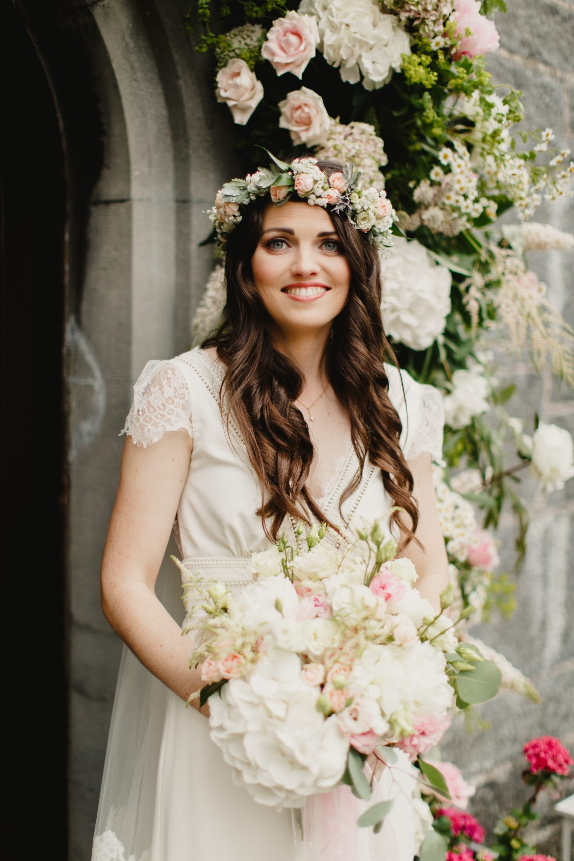 A beautiful bride wearing a flower crown with her hair left down in soft curls