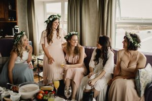Katie and her bridesmaids have a laugh in the bridal suite in the Dingle Skellig hotel.