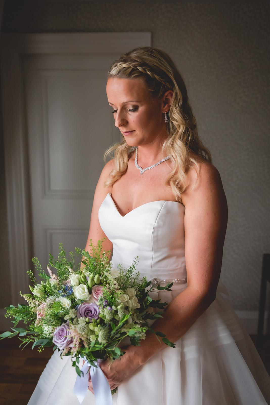 Beautiful bride Sinead holding her bridal bouquet