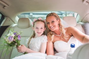 Sinead and Lily her flower girl drive to the wedding ceremony